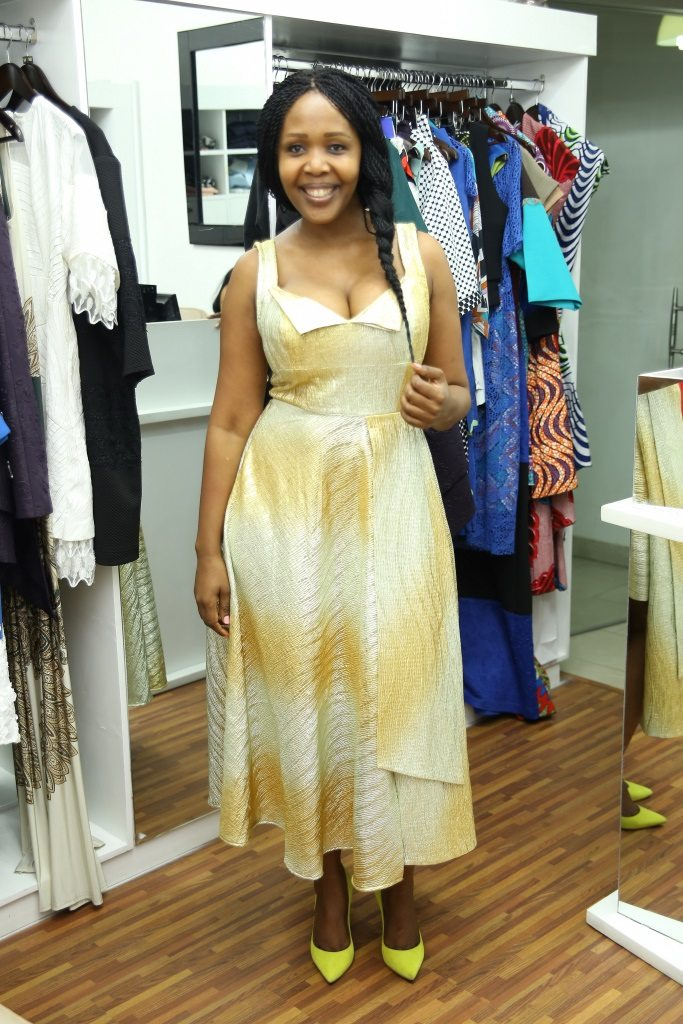 Mpho Laing trying out a gold dress by Meena
