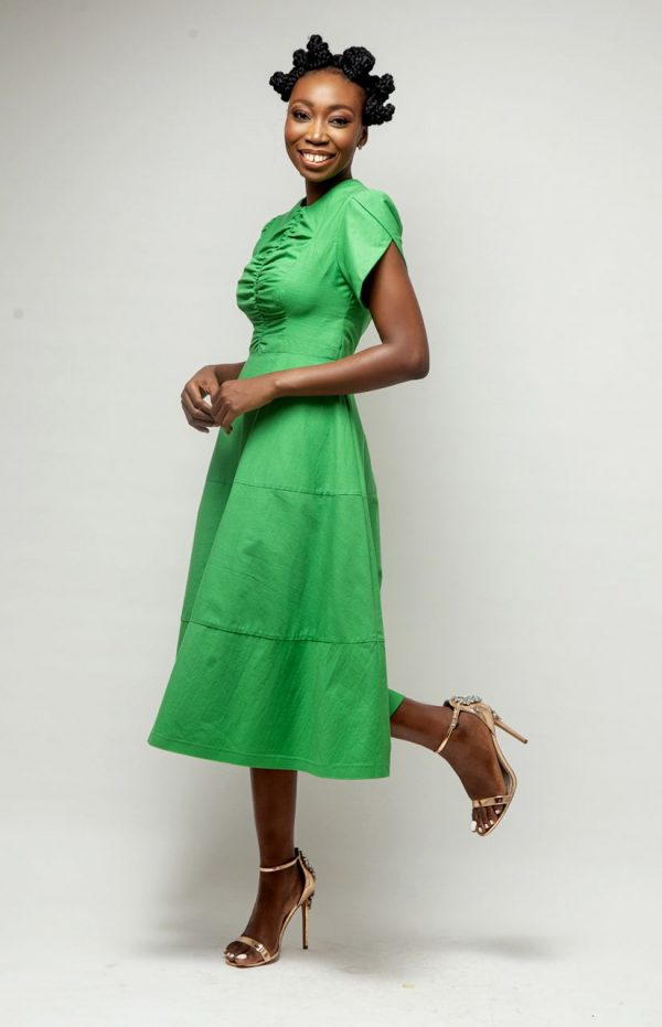 Lady wearing a Midi Green Dress